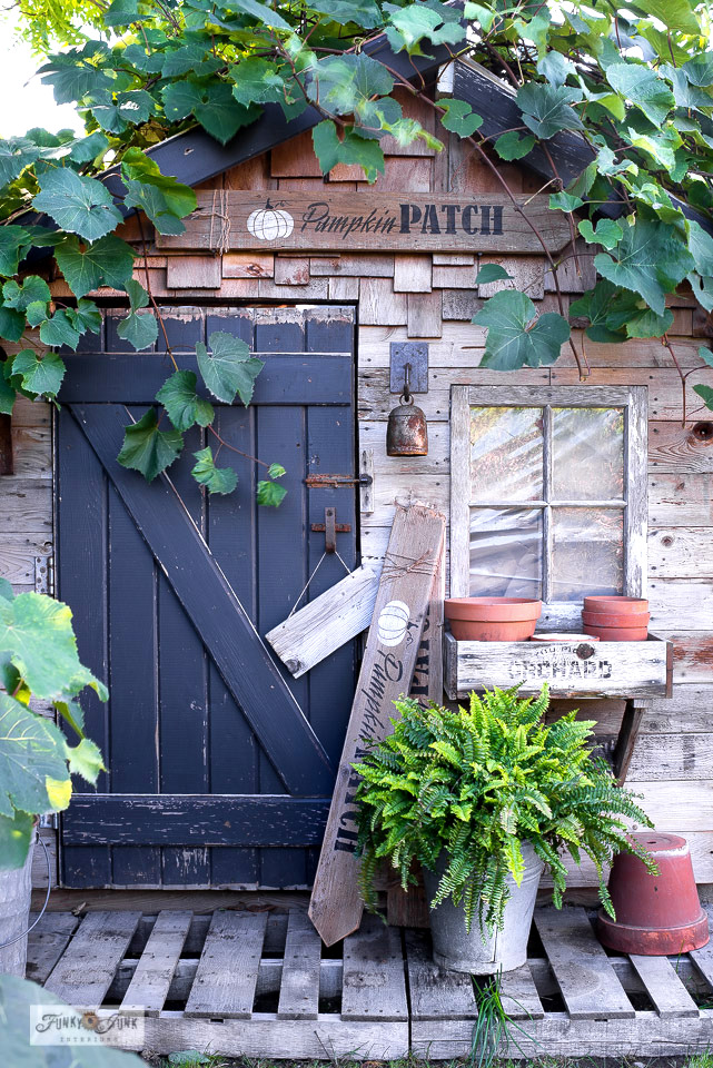Learn how to build and stencil a neutral fall pumpkin patch sign using 1 plank of wood! Featured is black lettering with a white pumpkin for a neutral fall look, complete with added twine and a paint splattering effect! Visit for full details.