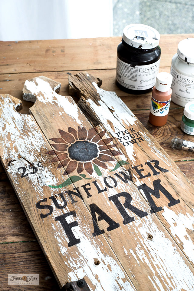 Learn how to build and stencil this easy rustic sunflower-themed fall sign with a flower shelf using reclaimed wood. Perfect for fall decorating while being productive too! Read the full tutorial HERE