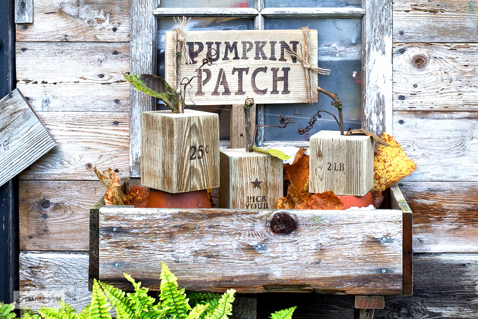 Learn how to make easy DIY wooden pumpkins (with a Pumpkin Patch sign) for fall decorating! Simple wood cuts, branches, stencils and paint are all you need to create this rustic neutral fall look! Visit tutorial with stencil tips!