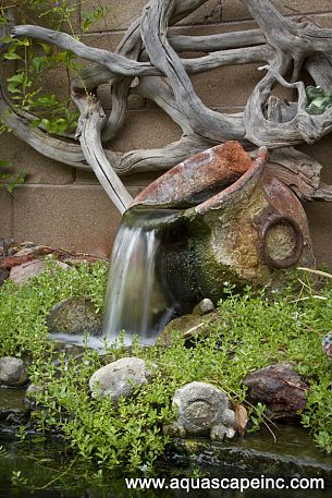 Pouring clay pot water fountain, by Aquascape Inc., featured on FunkyJunkInteriors.net